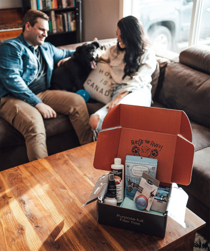 Happy couple with dog and Waggle Mail Subscription Box